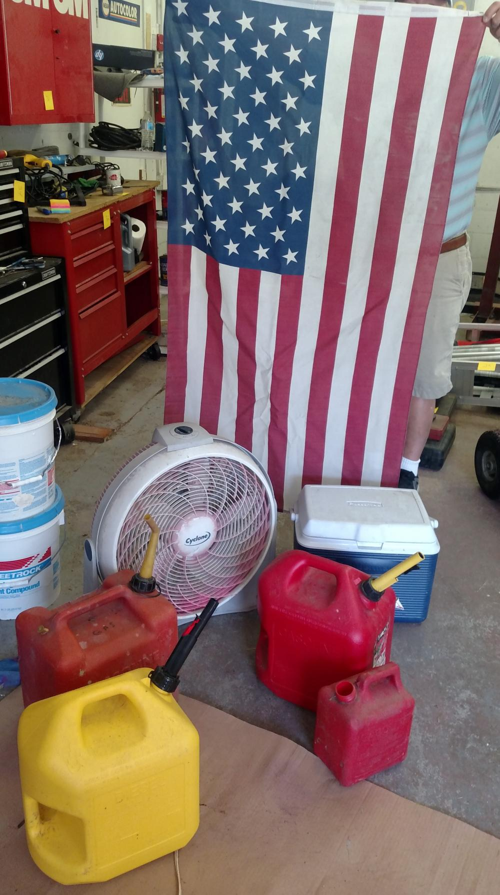 gas cans, fan, flag, cooler
