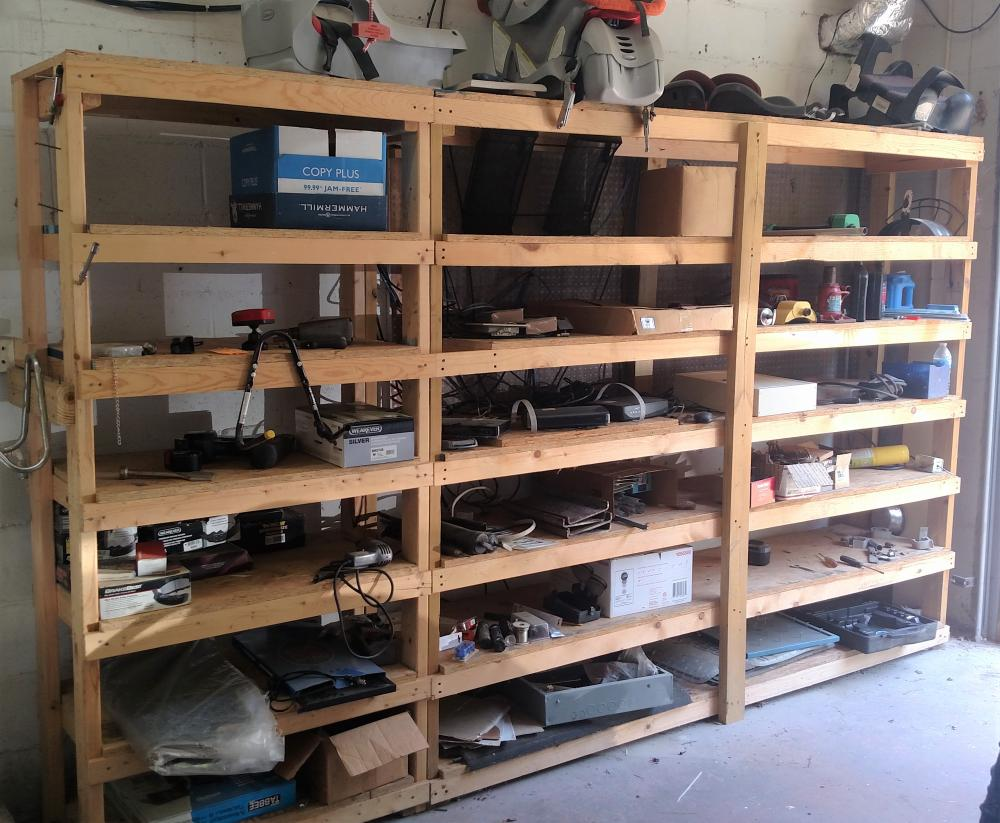 wood shelf contents-- contents only-- kids car seats, air checker, 12 ton bottle jack, grease guns, elec drill, air wrench, brake pads, elec open sign