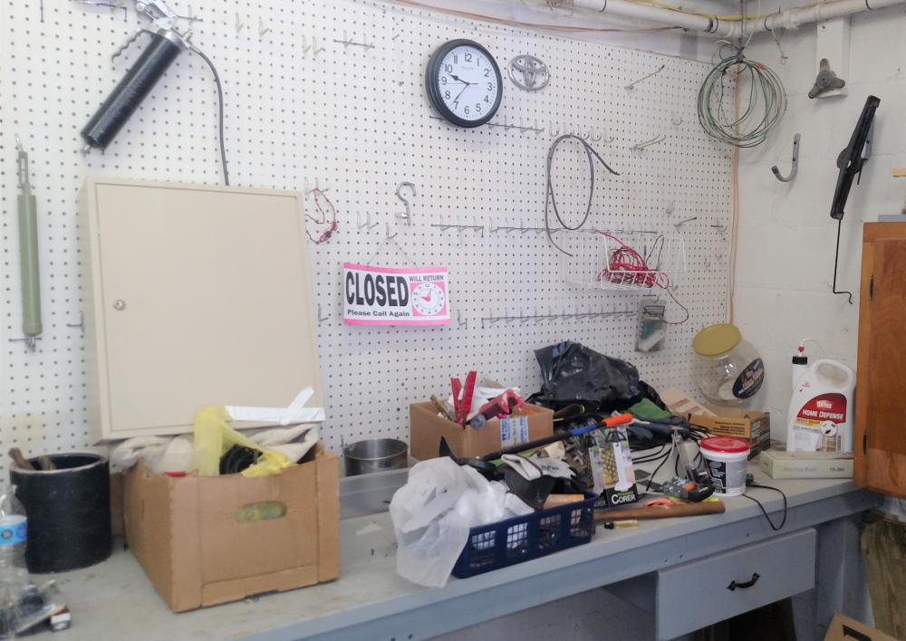 corner contents-- grease gun, clock, key box, magnet, gloves, misc joblot