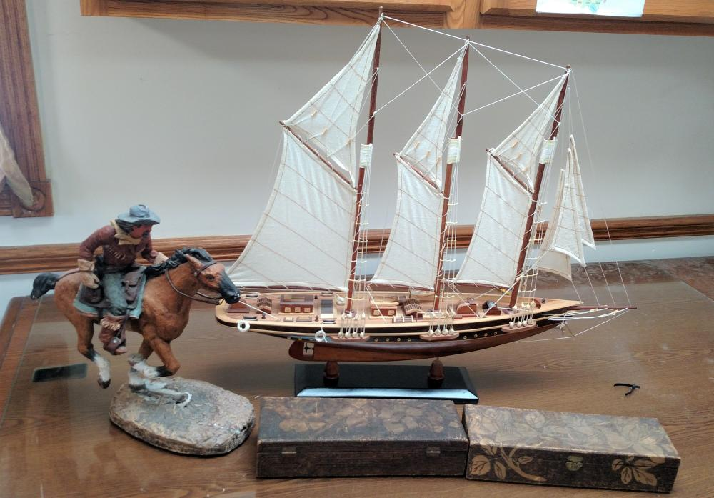"model ship, cowboy and 2 wood lift boxes-- ship is 27"" long and 24"" tall"