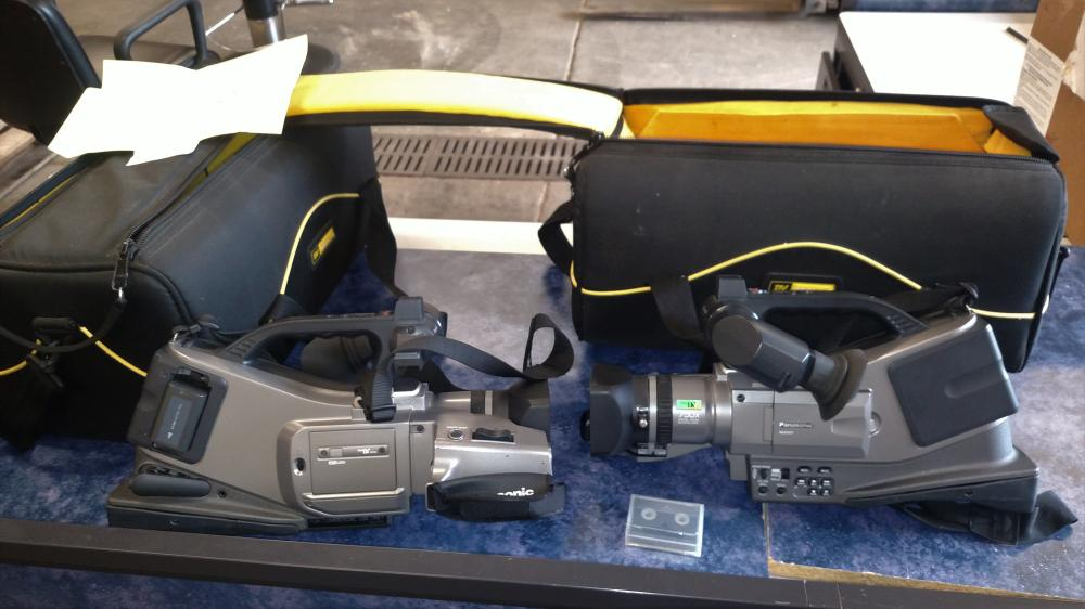 2 panasonic video cameras with cases- 750x digital zoom--1 battery