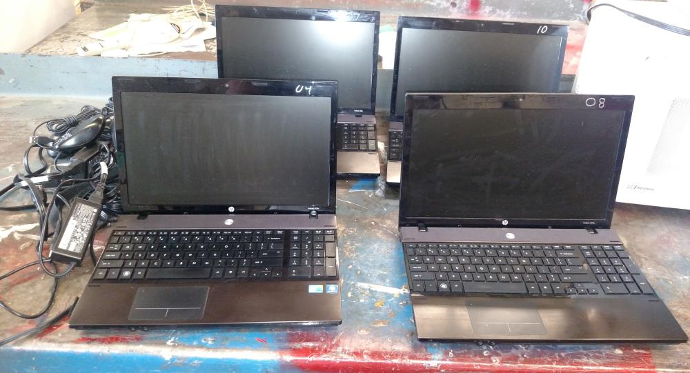 4 HP laptops with 3 chargers and 5 mice