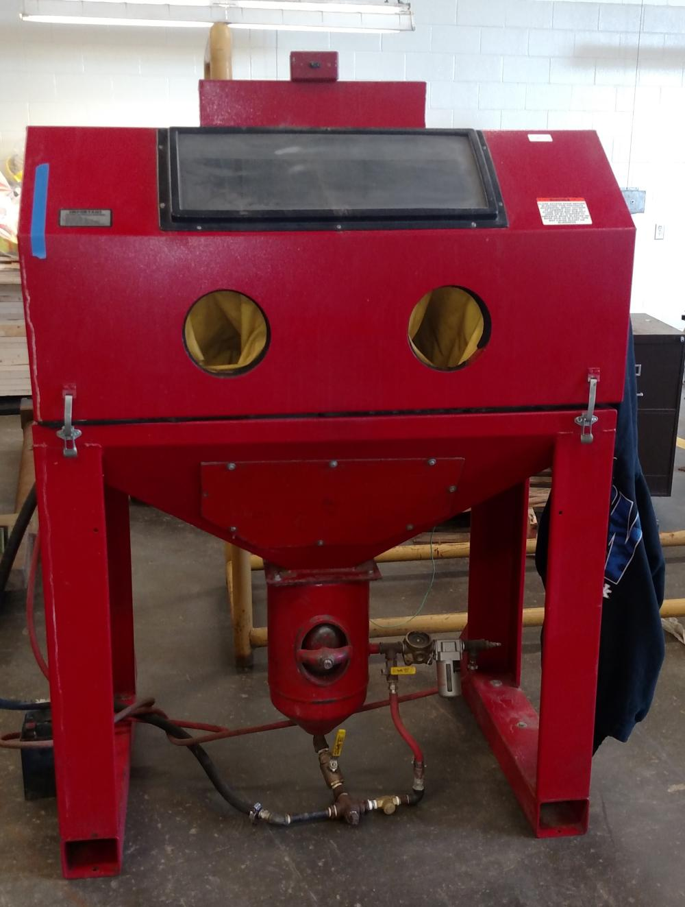 "red sandblaster 67"" tall, 48"" wide, 31"" deep"