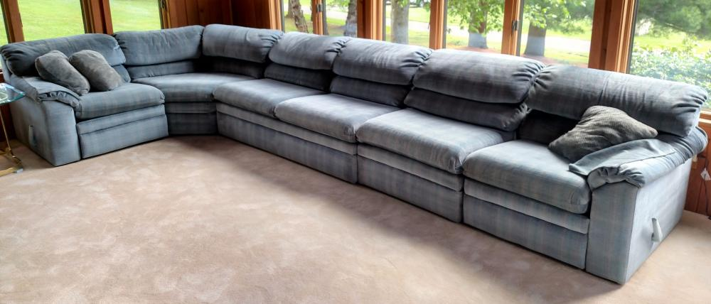 blue 4 pc. Sectional sofa with sleeper and end recliners 14 ft. long