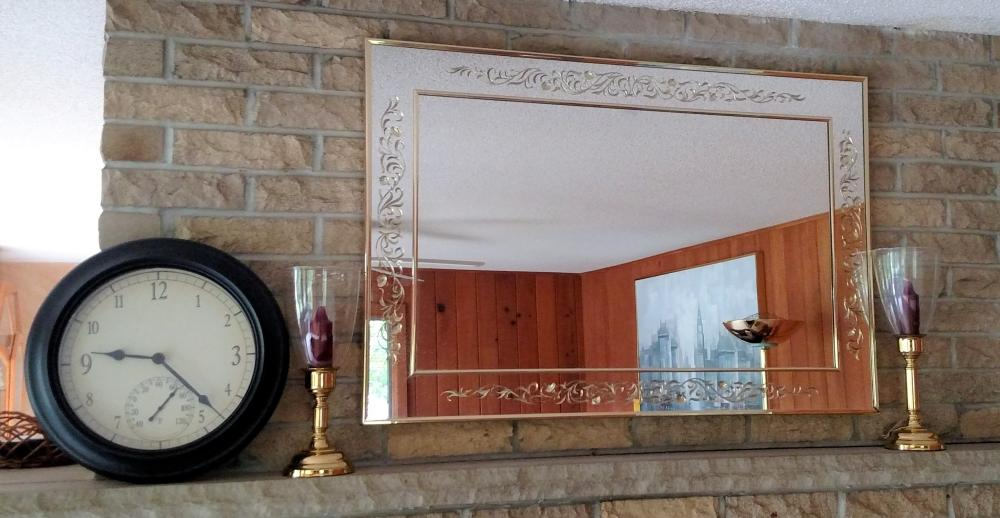 clock, mirror, candle holders