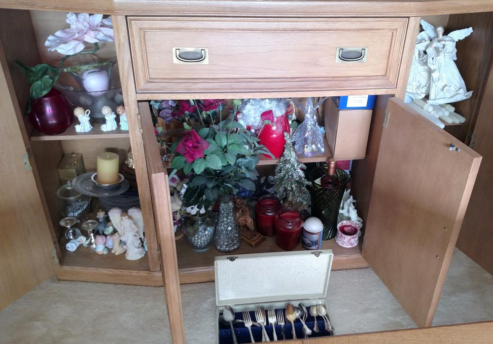 Buffet contents - Oneida silverplated flatware, candles, vases, figurines, flowers, glass plates
