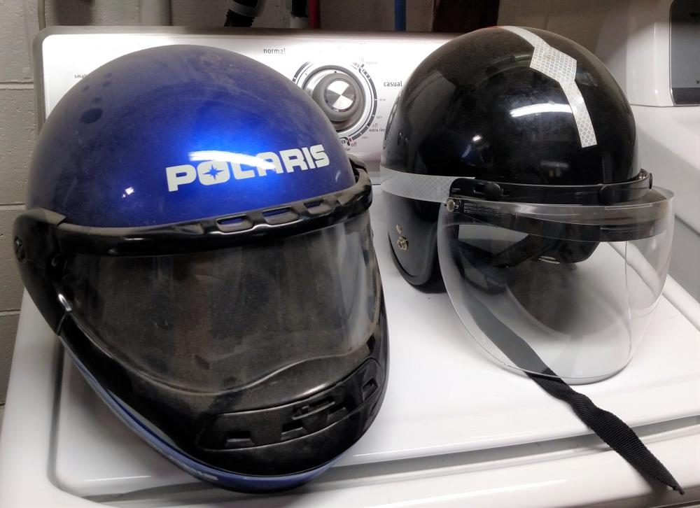 2 motorcycle helmets (Polaris - Medium size 7 1/4 - 7 1/8, other is Large size