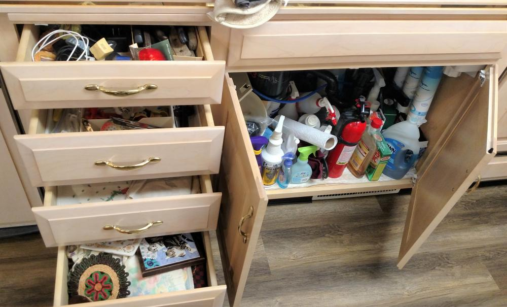 kitchen drawer items, dish towels, knives, cleaning products, junk drawer items