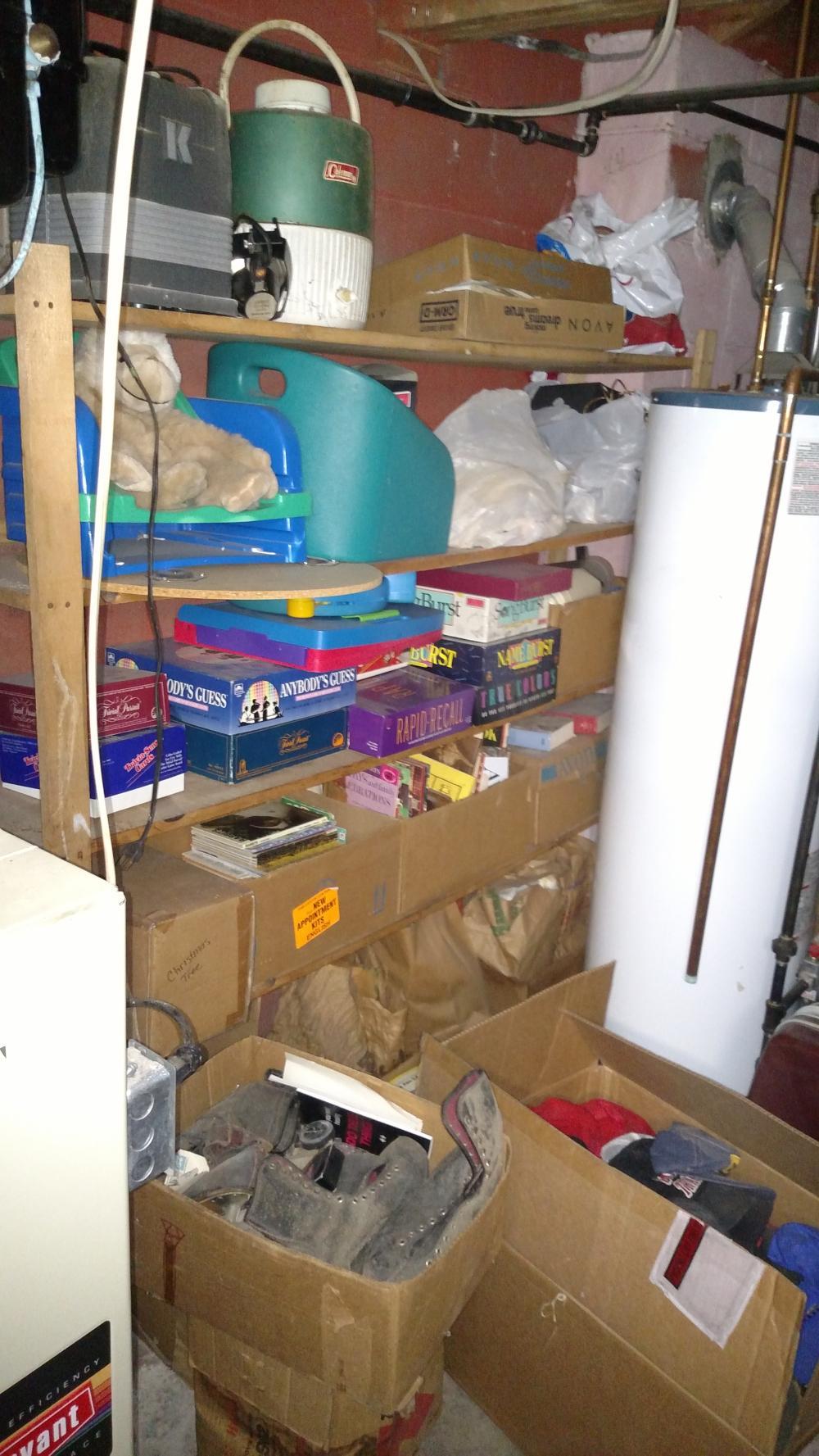 shelf contents - Coleman cooler, games, books, ice skates, kid's items, ball hats, pot luck misc. job lot