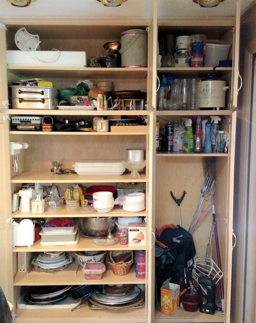 pantry contents-- trays, cleaning products, crock pots, hot dog forks, vases, misc housewares,