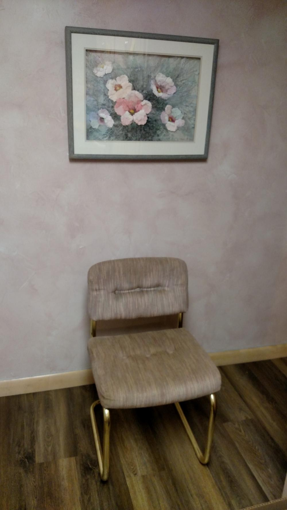 flower picture and padded chair