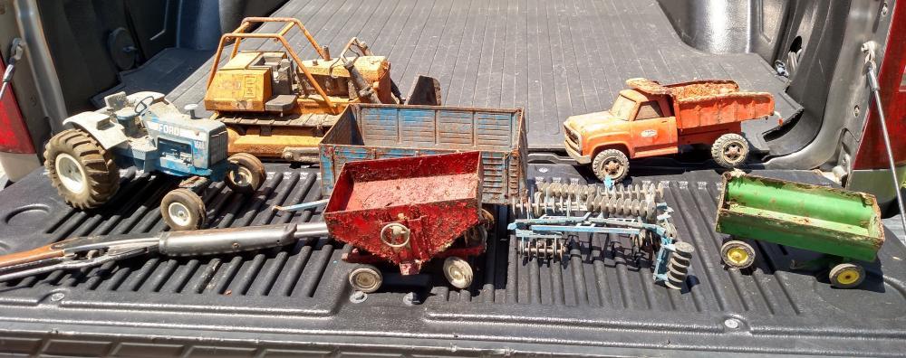 ERTL toy tractor, Tonka bulldozer, back hoe, Tonka dump truck, farm toys, Daisy pop gun (rough)
