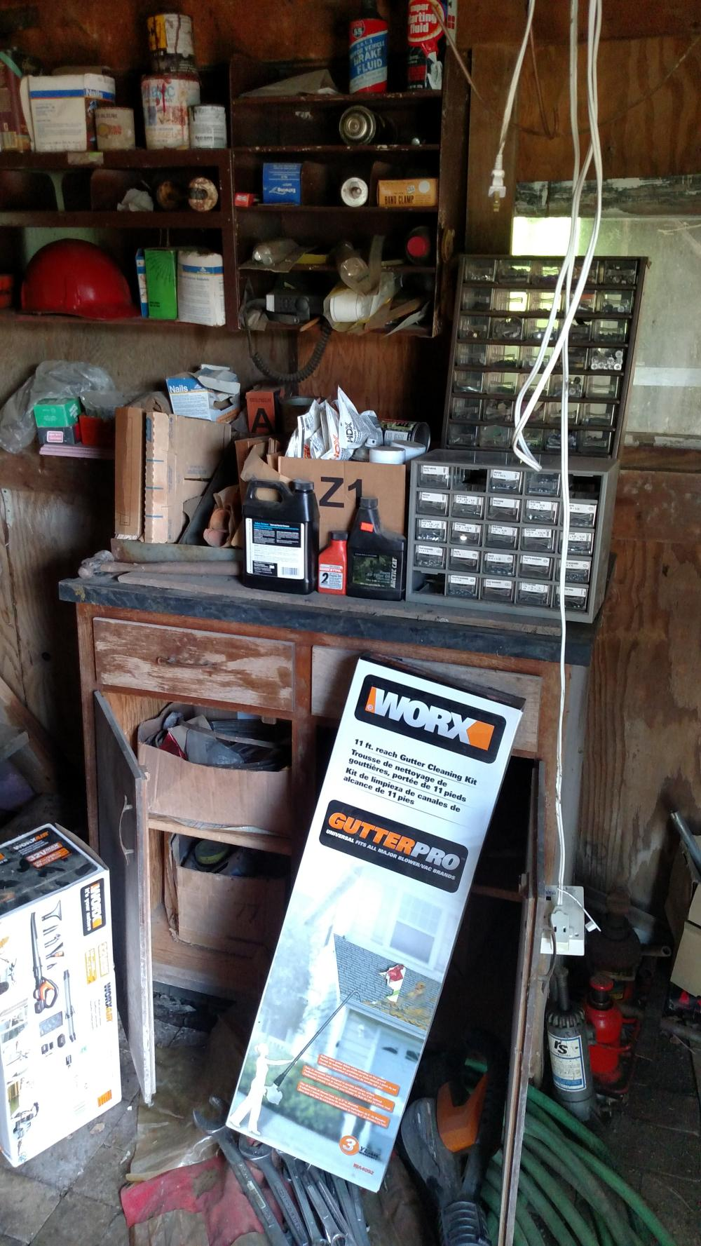 side wall contents - tool caddies, nuts and bolts, Craftsman wrenches, bottle jacks, Worx battery powered tools