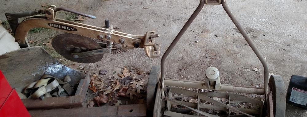 Brinley plow and Craftsman reel mower