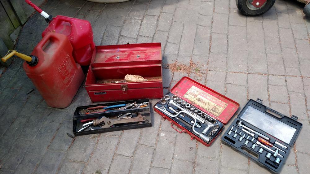 socket set, toolbox, 2 - 5 gallon gas cans