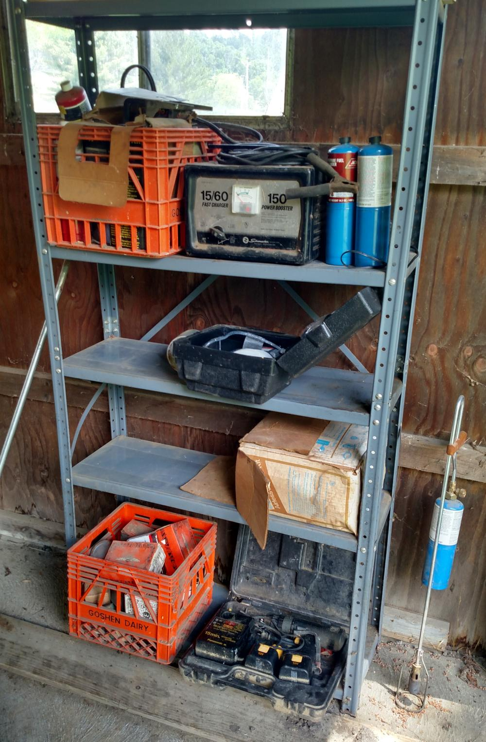 metal shelf and contents - battery booster, cordless drill, nuts and bolts, Goshen Dairy crate