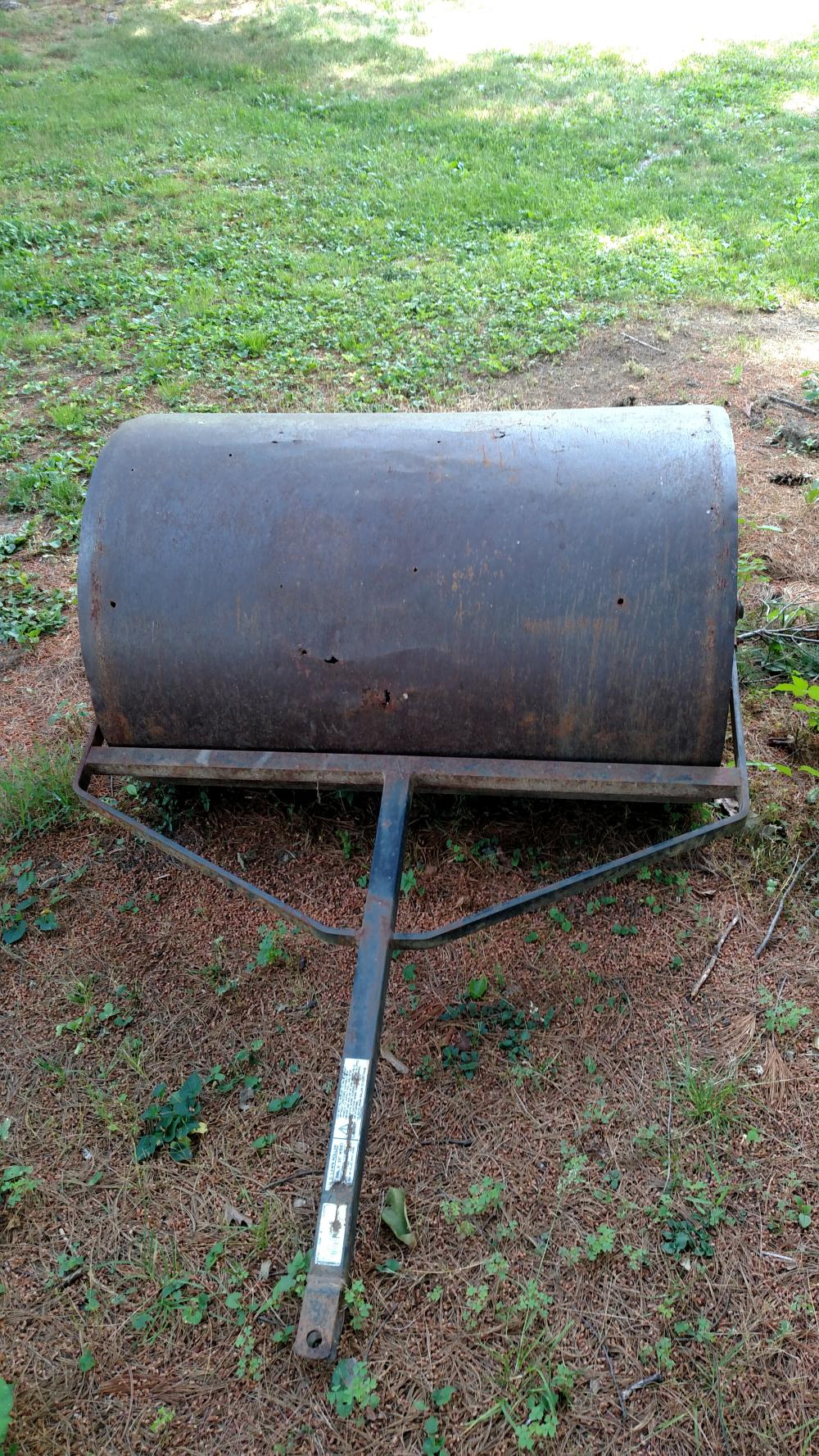 metal lawn roller (has holes in it)