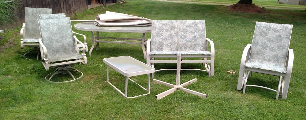 glasstop patio table w/ glider rocker, swivel rockers, umbralla and stand, coffee table (ready for a cleaning)