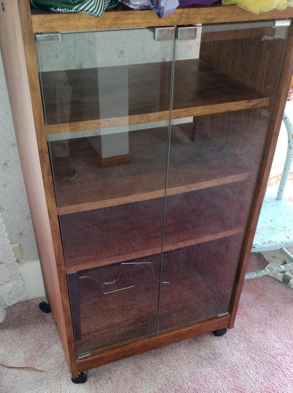 "O'sullivan glass door cabinet-- 23"" wide, 44"" tall, 16"" deep"