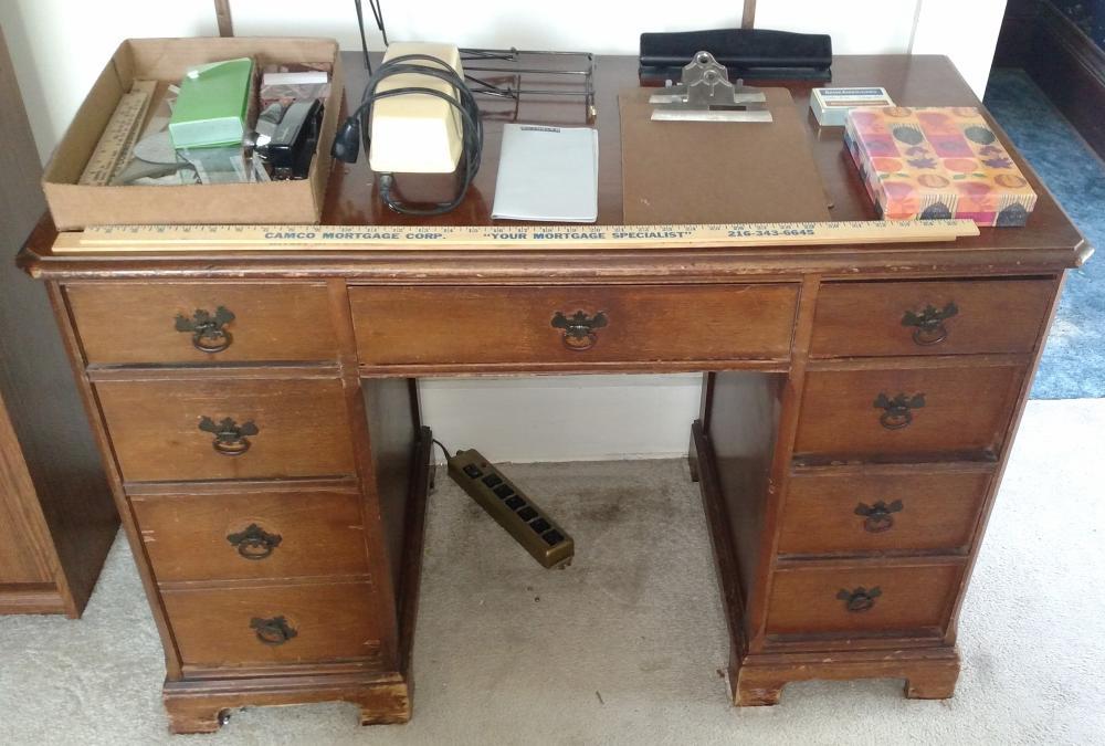 "desk with misc desk supplies, pencil sharpener, yard sticks, clip board--- 44"" wide. 30"" tall, 22"" deep"
