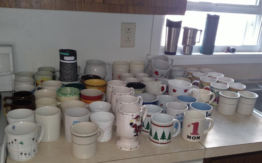 coffee cups, travel mugs, box of paper towels