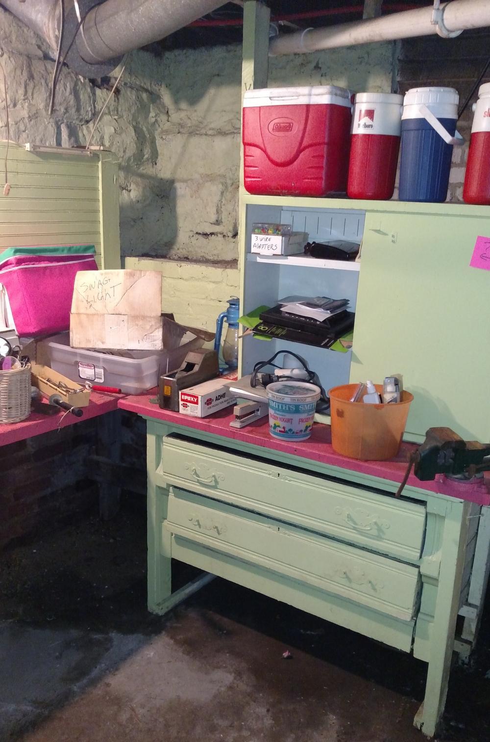 "coolers, vise, lantern, ext cords, green metal sliding door cabinet, 2 drawer wood cabinet base (49"" wide, 32"" tall, 23"" deep)"