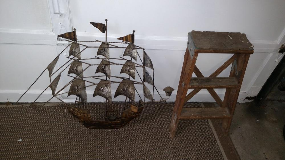metal décor wall hanging( damaged rudder) and wood ladder