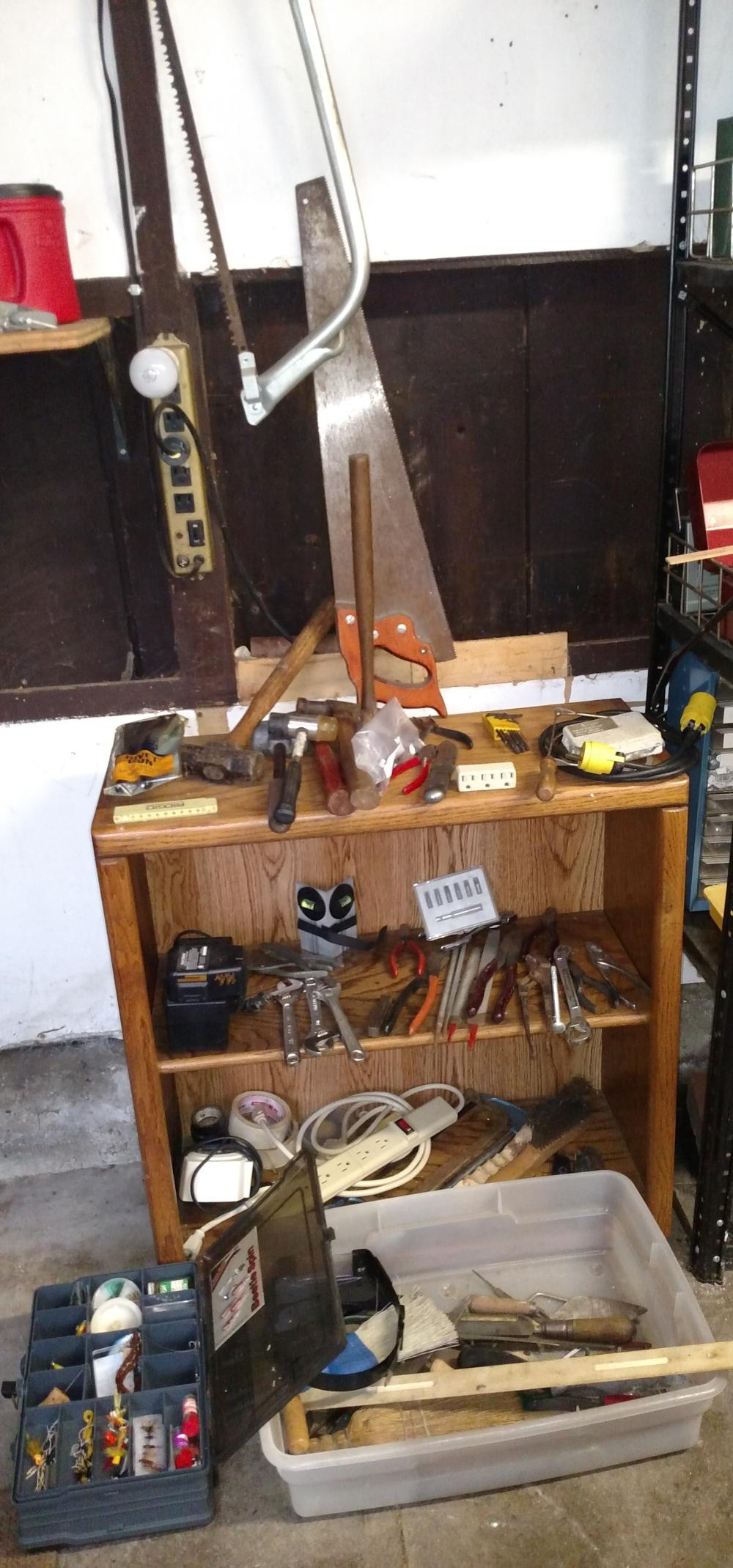 garage wall items--tackle box w/ misc fishing items, saws, wrenches, hammers, misc tools