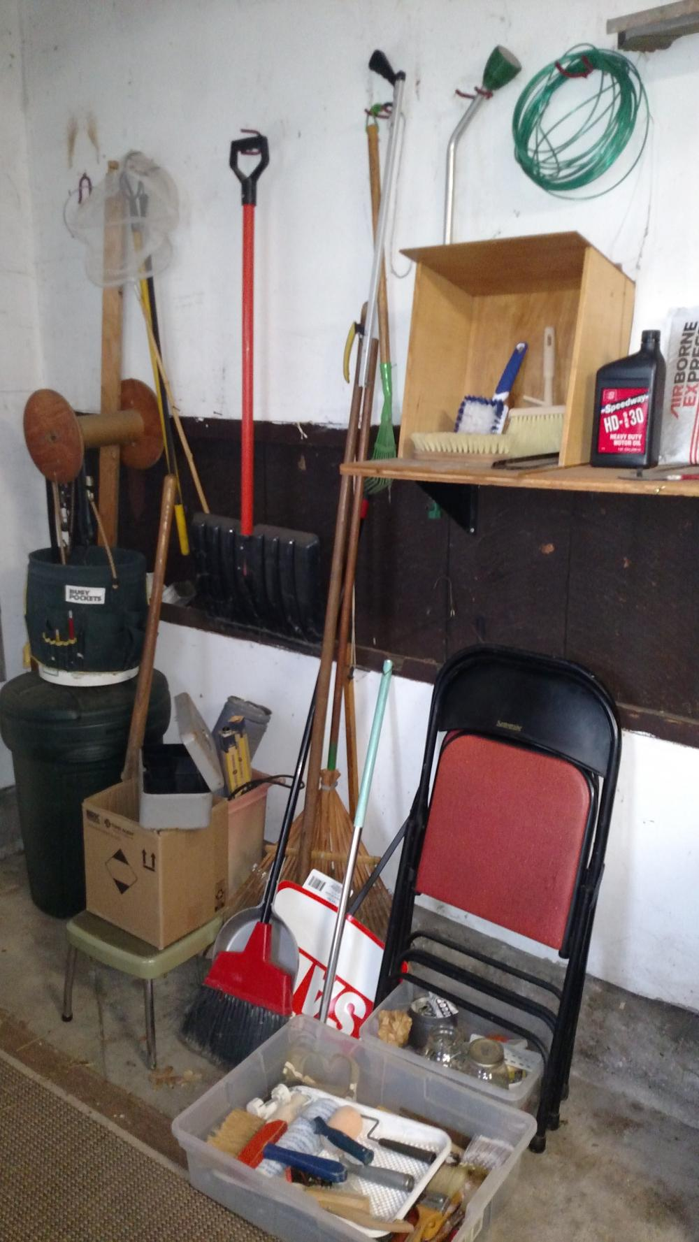 garage wall items-- paint brushes, rakes, broom, 2 card table chairs, bucket, trash can, misc joblot