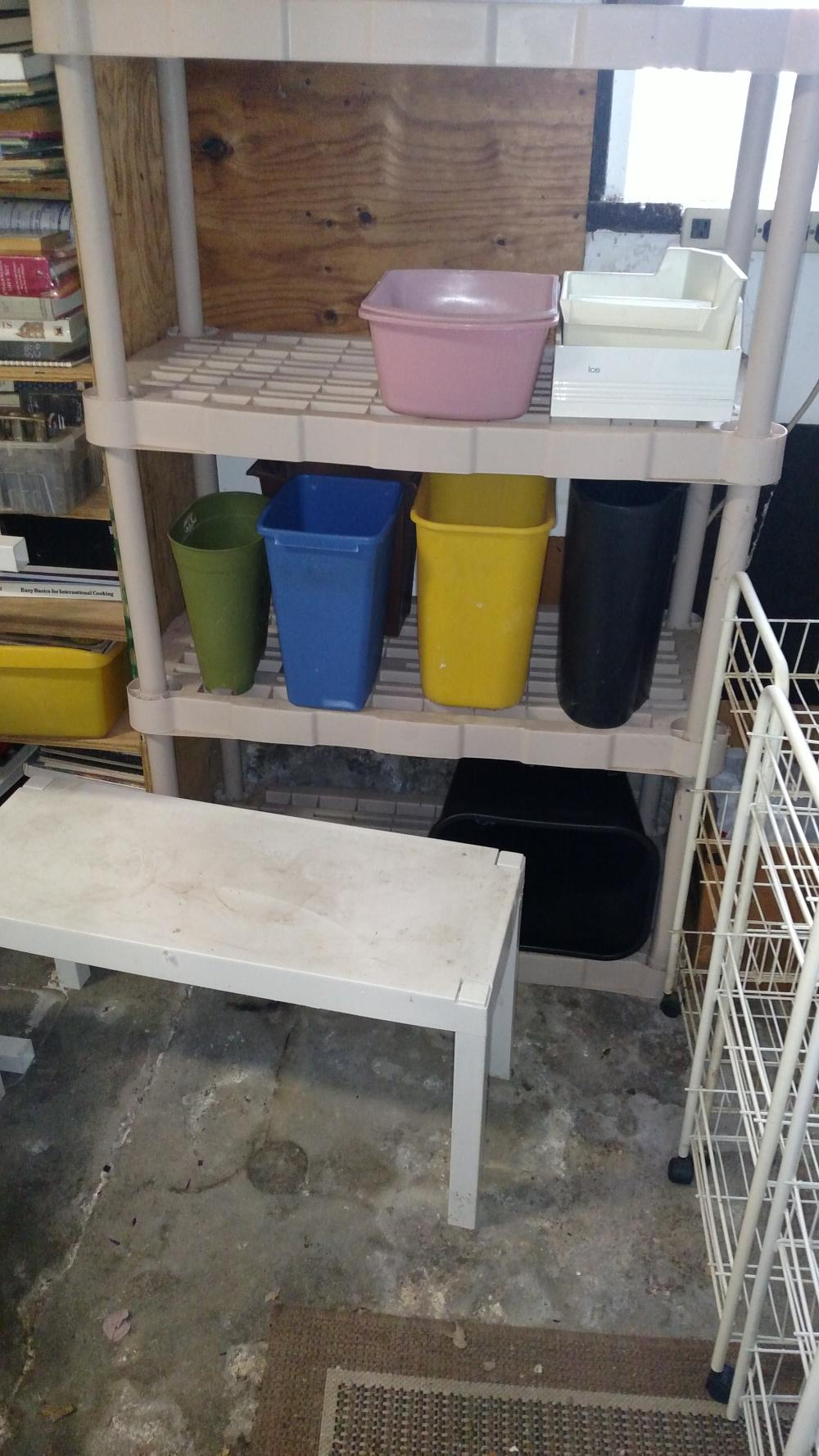 plastic shelf and contents-- books, binders, plastic cans- misc