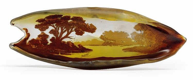 An overlaid and etched leaf shaped glass tray by Gallé,