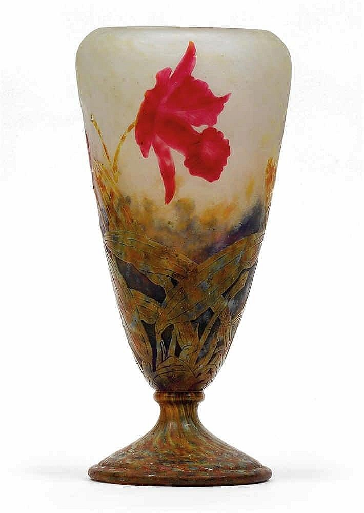 An overlaid and etched glass vase by Daum