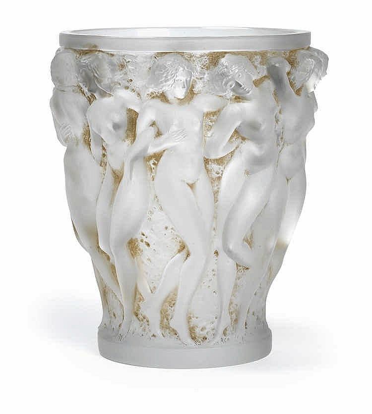 """A """"Bacchantes"""" moulded glass vase by René Lalique,"""