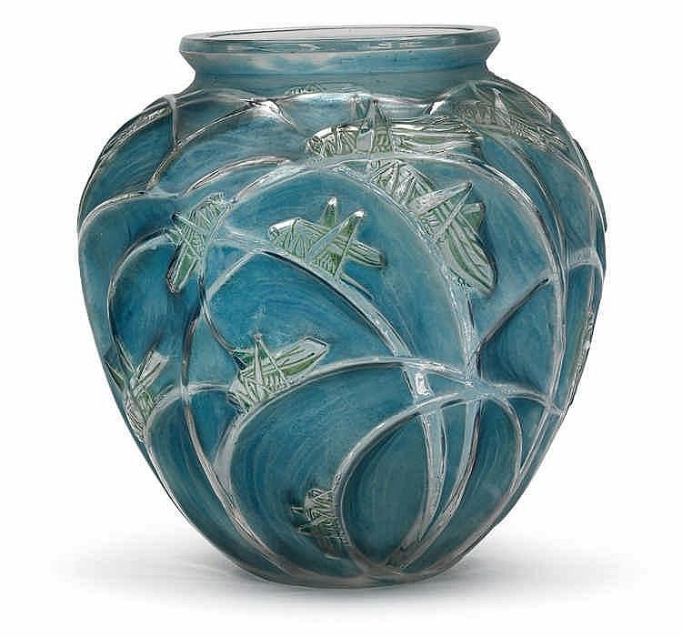 """A """"Sauterelles"""" moulded glass vase by René Lalique,"""