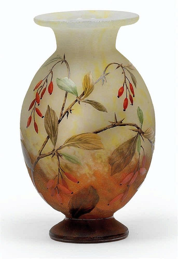 An etched glass vase by Daum
