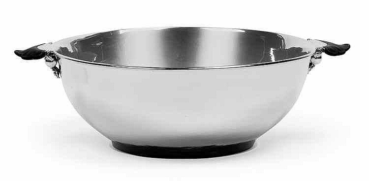 A handled bowl by Georg Jensen,
