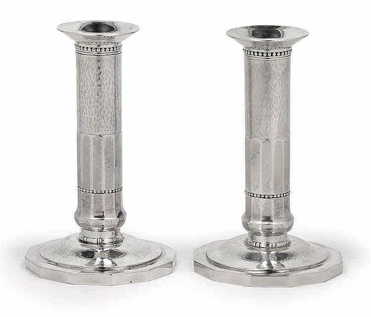 A pair of candleholders by Georg Jensen,