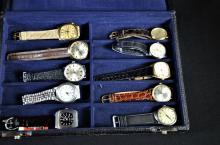 Coffret contenant 10 montres-bracelets, dont certaines neuves, de marques différentes comme...