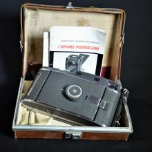 Polaroid Land Camera in leather box with descriptions
