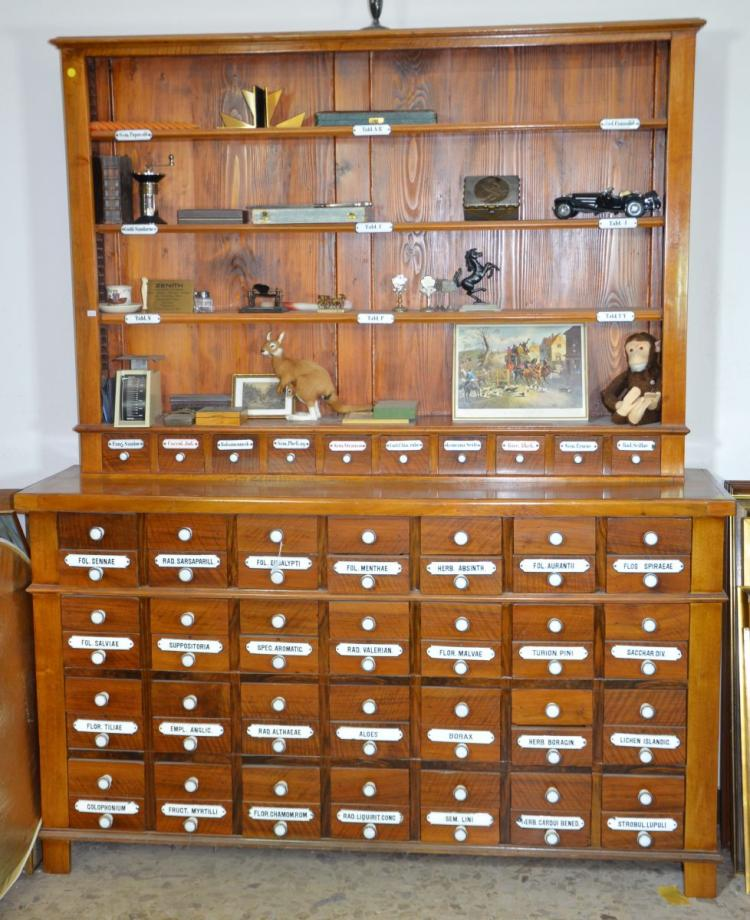 pharmacy cabinet with 56 drawers and enameled lettering ca