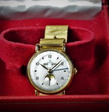 Montre tout or OMEGA avec triple quantième et phase de lune. Bracelet d'origine et box.
