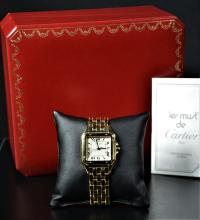 Wristwatch CARTIER completely made of 18ct gold (110 g). With box. Very good condition.