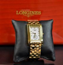 Wristwatch LONGINES completely made of 18ct gold (120 g). Quartz movement. Very good condition.