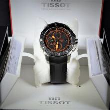 Automatic steel chronograph Tissot. With natural rubber wristband and butterfly clasp.
