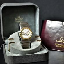 Two-tone chronograph OMEGA Constellation. Quartz movement. With box and papers. Very good condition.