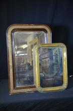 Collection of two mirrors, frame with a relief-like technique, the smaller golden mirror shows signs...