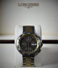 Automatic chronograph LONGINES. With days and dates display. Made of titan and 18ct gold. Ø 40mm....