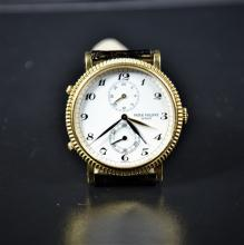 Golden wristwatch PATHEK PHILIPPe Travel Time with original buckle. Very good condition.