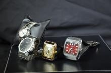 Lot with 4 Wristwatches. One TAG HEUER Quartz, one automatic TISSOT, one LONGINES Quartz and gilded...