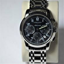 Chronograph LONGINES in steel. Diameter 45 mm. With box and papers